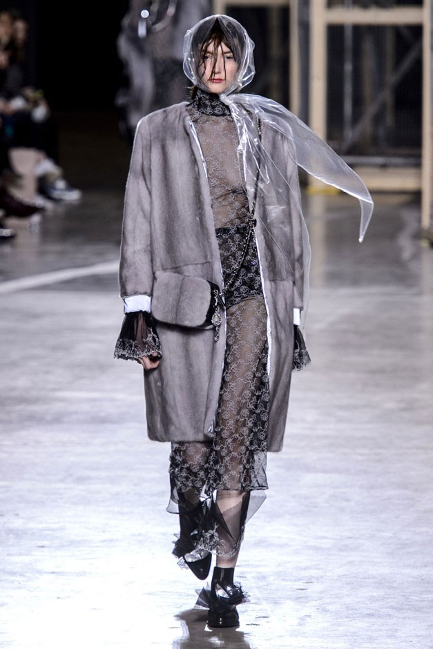 <strong>Christopher Kane</strong> <br><br> From the florals, he moved into a series of grey furs that begged to be touched. But instead of showing them with something super lady, he threw them over sheer lace dresses and tough black booties.