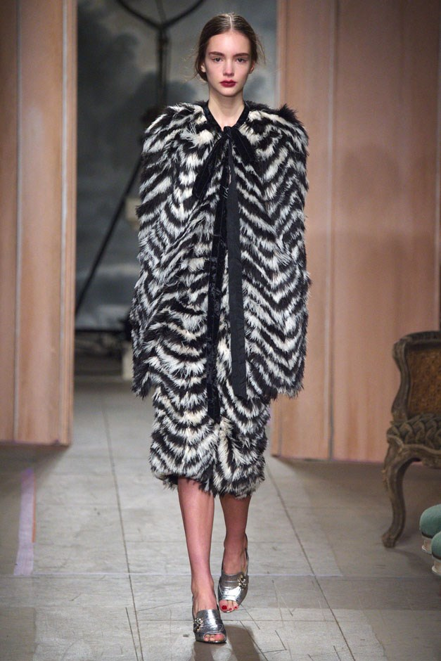 <strong>Erdem</strong> <br><br> Moralioglu seem to reign in the usual explosion of print-on-pattern-on-print, using a more subdued palette. Which made a handful of shimmering gowns and a striking black and white patterned fur stand out all the more.