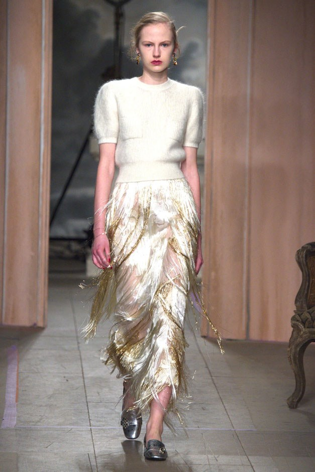 <strong>Erdem</strong> <br><br> Sure, this collection didn't have the energy and newness of past collections, but we are solidly in the camp that believes designers are allowed some off seasons. And if Moralioglu's off seasons can still deliver paired back elegance like a secretary look reworked for cocktail hour—namely a cream and gold sweater and pencil skirt—then bully for him (and us).