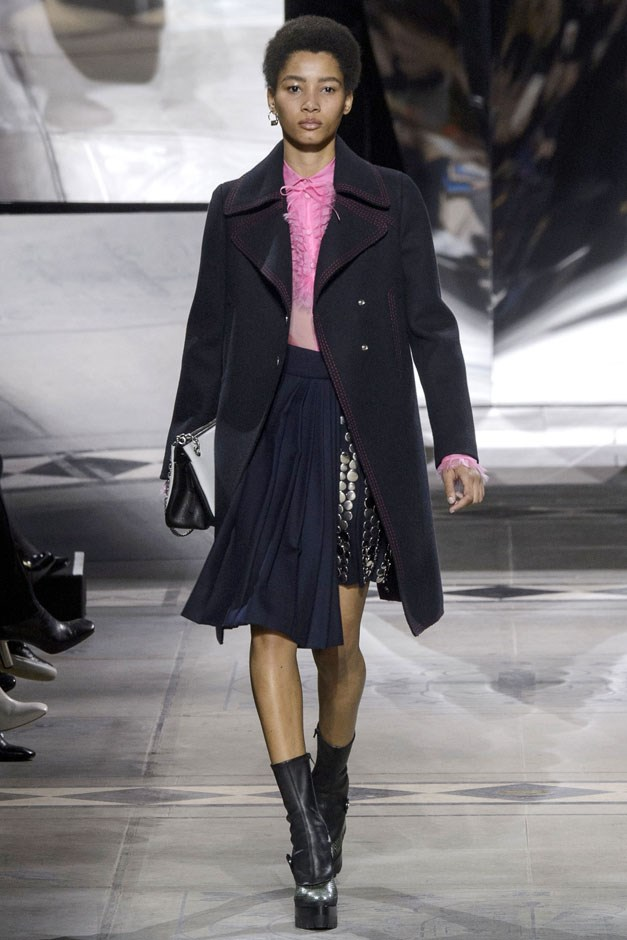 <strong>Mulberry</strong> <br><br> Coca delivered wonderfully tailored, very English coats that were worn with daytime blouses and skirts with enough quirky details to keep them cool and interesting. The double-breasted military cape was done here with extra rows of buttons, while schoolgirl pleated skirts were spliced with sequins and her prim blouse showed up in bright pink or olive drab.