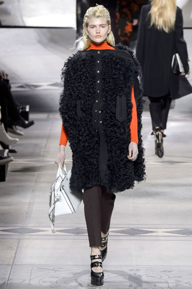<strong>Mulberry</strong> <br><br> Oversized shearlings topped turtlenecks in bright primary hues while a green and orange rose print worked on both a strappy wrap dress and a hooded silk coat. leather was a major message here, showing up in olive ruffled shirt dresses, pleated wrap minis and leather pants worn under leather a-line dresses.