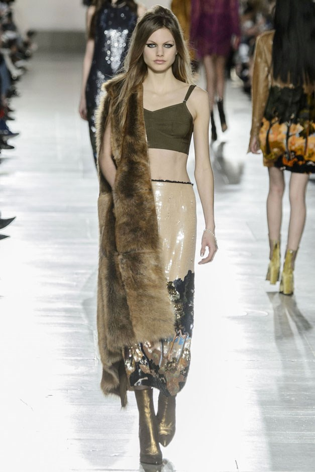<strong>Topshop Unique</strong> <br><br> Printed silks with pastoral scenes were inspired by none other than Shakespeare's Winter's Tale—we are in London after all. Worn with a bra top and fur vest, the look was still very much for the Topshop ingenue.