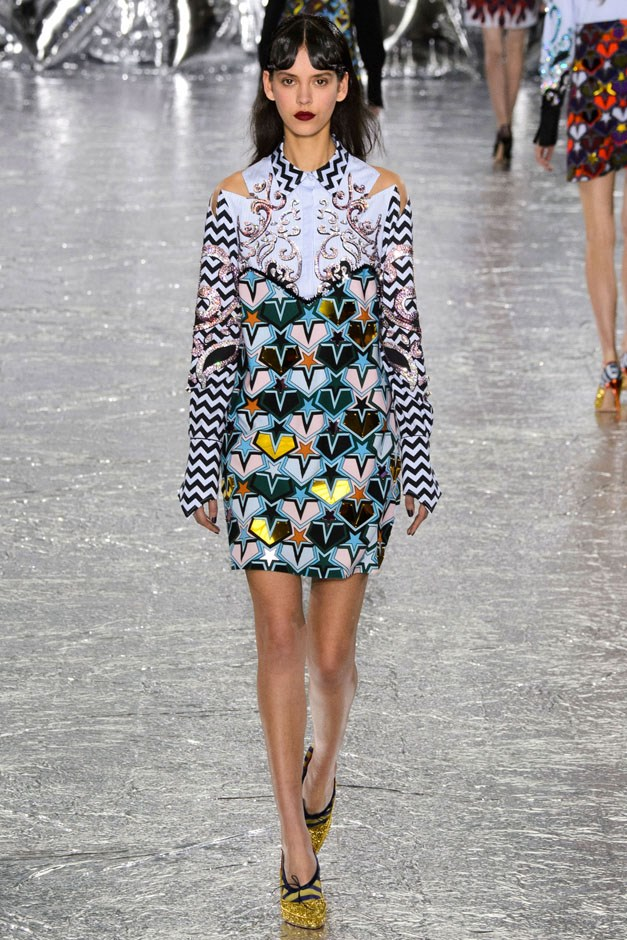 <strong>Mary Katrantzou</strong> <br><br> Perhaps the best part of a Katrantzou show—even if colour and print and energy isn't your cup of sartorial tea—is that the designer clearly loves and enjoys what she does, which is infectious. She must study the other great pattern play masters, like Prada, and then try to best herself. Black and white zig-zag sleeves on a minidress with a silver-embroidered cowpoke yoke and a blue multicolored heart jacquard just should not work for anyone. And yet it does. As did so many other wonderful imaginative exits.