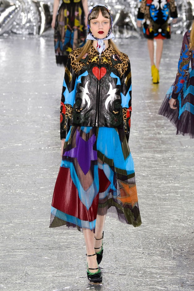 <strong>Mary Katrantzou</strong> <br><br> Leather and fur jackets got the works here, too. They pushed the boundaries of what can be done, spliced, coloured and printed—and all the bright motifs that the designer employed on silk was used on mink and leather. The black leather jacket was reborn as a heart-beating, leopard-printed moto jacket meant to be worn with a babushka-style scarf and swingy pleated chiffon skirt.