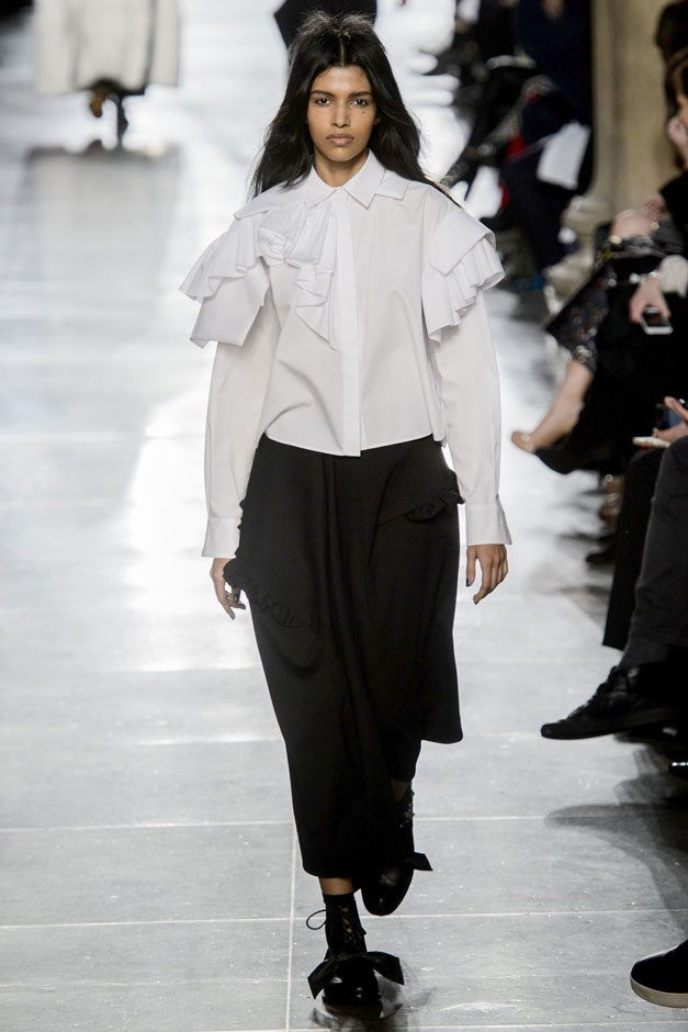 """<strong>Preen by Thornton Bregazzi</strong> <br><br> This fall was romantic glamour, culled from artists and writers of the past. Their message to the messy-haired models was, """"You are a Poetry Groupie. You are the authors of your own destiny. You are the Cherry Bomb!"""" So out came white blouses ruffled in poet sleeves and worn over black skirts and pants laden with gothic romance, oversized floral dresses worn with knits or bow blouses and tons of checked coats and sheer dresses."""