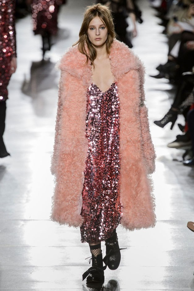<strong>Preen by Thornton Bregazzi</strong> <br><br> A handful of looks came out in dazzlingly pinkalicious sequins, done as asymmetric skirts, a great cocktail number with loose peplum and a looser grunge dress worn with a fluffy peachy-pink shearling. For balance, it was worn with tough-ish black ankle boots, some which were detailed with crystal bracelets.