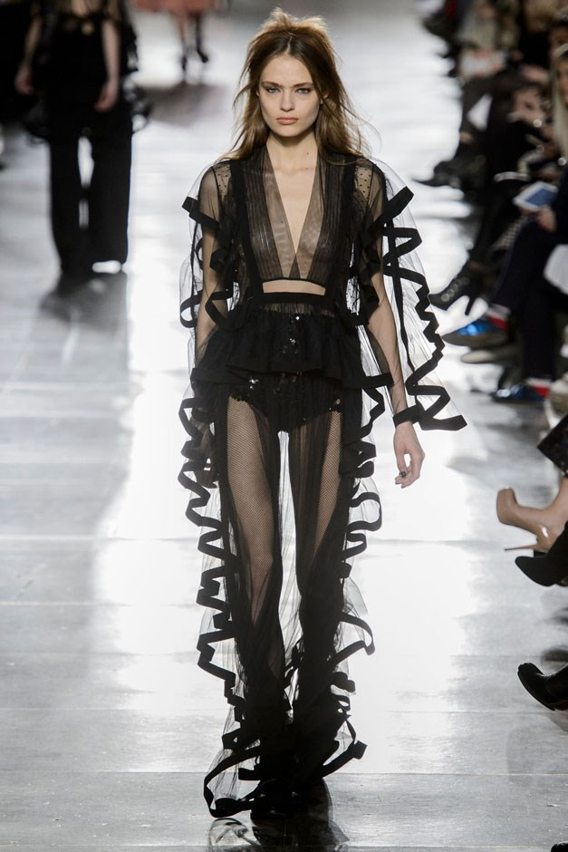 <strong>Preen by Thornton Bregazzi</strong> <br><br> The duo ended with a trio of satin-trimmed gauzy black negligee-like rompers. They cut a striking picture against the sets' Pepto-coloured trees. But we know all gothic romances and poets ended up in bed anyway, right?
