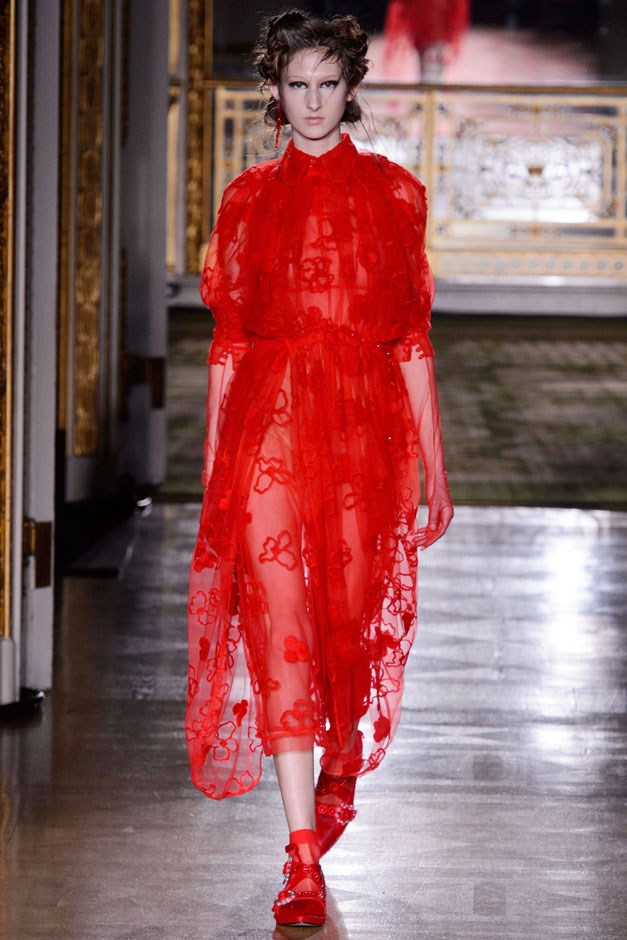 <strong>Simone Rocha</strong> <br><br> Rocha's go-to shades are white, black, pink and red with the occasional dose of tweed. The trick came with the twisty, turn-y, sheer, floral-appliqué approach that's so recognizably hers.