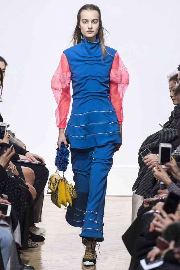 """<strong>J.W. Anderson</strong> <br><br> Tunics and flared pants showed up with gauzy sleeves and zippered details. It was a bit sci-fi done head-to-toe, but this is the kind of look you'd see at a party and think """"wow."""""""