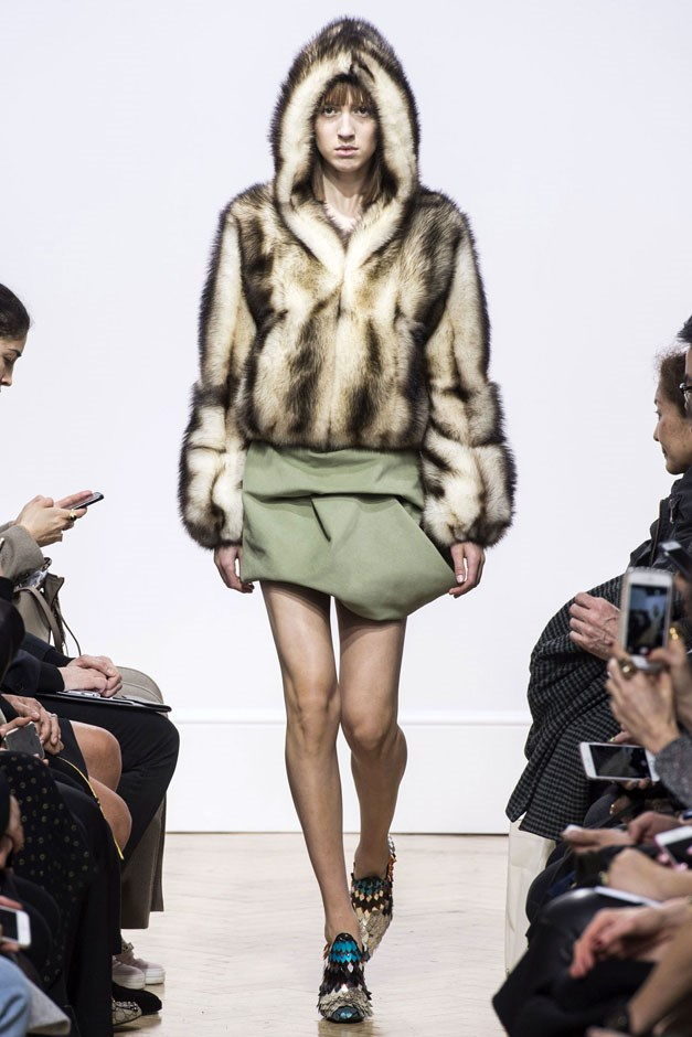 <strong>J.W. Anderson</strong> <br><br> Hoodies and outerwear were done in different fabrics and materials, from fur to quilted silk, some with a Japanese warrior feel, others with tri-colour trims and subtle frills. He paired voluminous tops with voluminous minis, accented with zippered mini hoods and capes. And every look was about proportion, texture and finish. One of the best looks was a black leather skirt, it's cloud-like panels outlined in zippers.