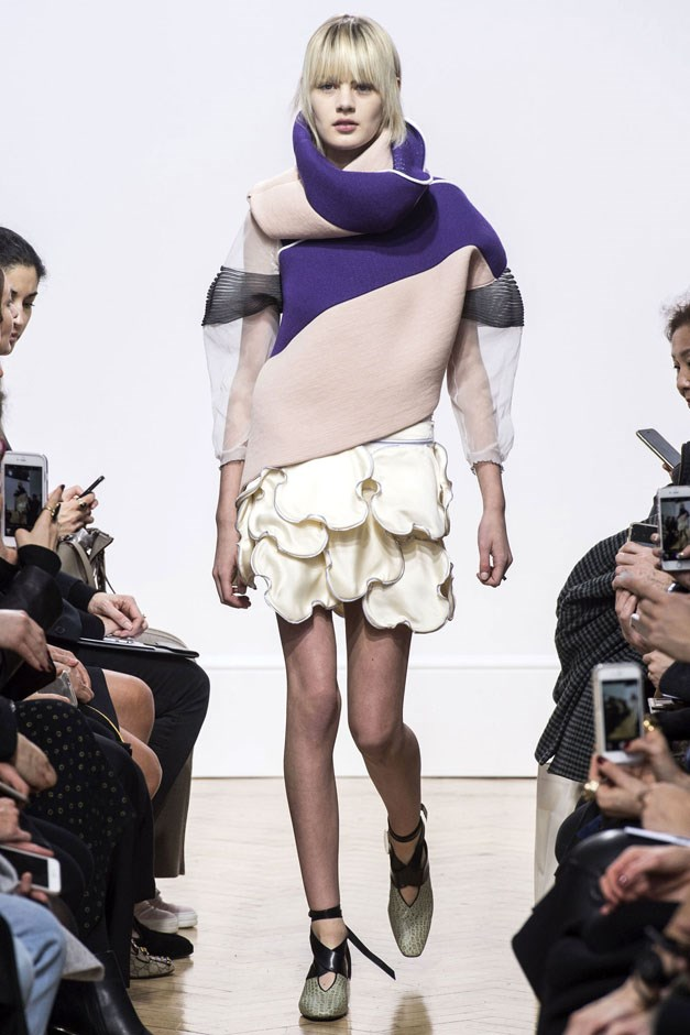 <strong>J.W. Anderson</strong> <br><br> That same cloud idea was seen a few looks later in a cream silk version that created a softer, more feminine line, especially paired with an asymmetric pink and purple sweatshirt with a looping turtleneck. As far-out as some of it may have looked, it's a sure bet that this runway will be influencing silhouettes of others for next season. Anderson is quickly proving himself to be one of fashion's brightest new guard.