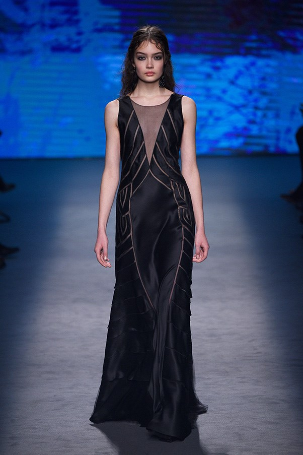 <strong>ALBERTA FERRETTI</strong><br><br> The finale offered cleaner silhouettes and gowns that showed off Ferretti's tailoring and draping chops. A midnight gown with gauze strips was both minimal and sensual, modern and strong. This woman found her own way out of the woods.