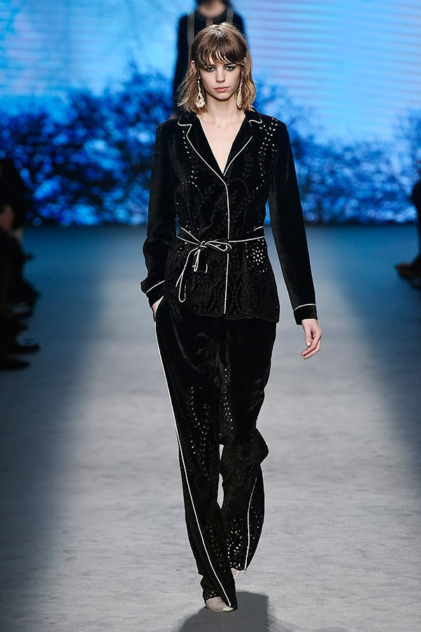 <strong>ALBERTA FERRETTI</strong><br><br> White-trimmed black pajamas with peekaboo cut-outs made a cool and sophisticated option for the evening suit, as did its night-dress version.