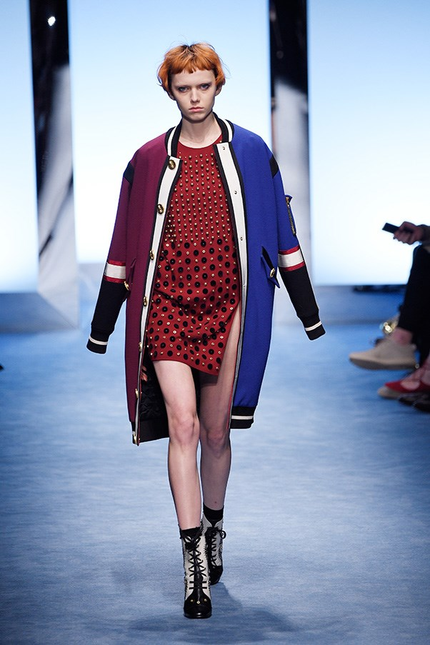<strong>FAUSTO PUGLISI</strong><br><br> Fausto Puglisi has a thing for America. And for fall, he wore his love on his sleeve, head and hip. Varsity stripes, red-white-and-blue, palm trees and some NYC values were on display in a collection that was, for Puglisi, more polished and less punk than usual.