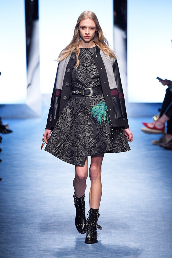 <strong>FAUSTO PUGLISI</strong><br><br> The Miami-LA palm tree grew out of buttons and baubles along skirts at the hip, while studded motorcycle boots gave varsity jackets and letterman sweaters a bad vibe. As did a handful of police-style knit hats emblazoned with NYC.