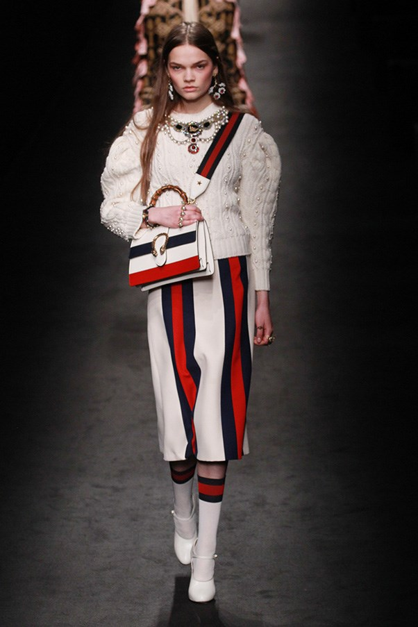 <strong>GUCCI</strong><br><br> And let's not forget the way Michele has handled the Gucci logo and stripes. Even the most branding-averse fashion-lovers can't find fault with the way the house's signature colors and double-Gs have turned into cool patterns and prints, sometimes as varsity stripes or abstracted prints on a flippy skirt or in the bodice of a grand dame-worthy gown in green (another house standard).
