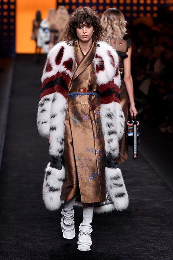 <strong>FENDI</strong><BR><BR> Less seasonless are the furs, but the woman wearing these demonstrative coats isn't concerned about such things. Where Fendi's furs have been of the futuristic or louche boudoir feel the past few seasons, for fall, it went all out glamour. There was a Cruella DeVil oomph to these larger-than-life, colourful, printed and patterned toppers.