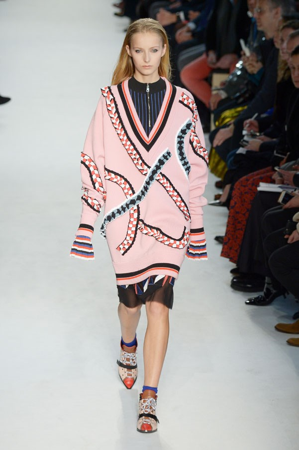 <strong>PUCCI </strong><BR><BR> He supersized duster coats and varsity sweaters in his bright palette, pairing them back to sleeker silhouettes like zip-up ski layers or skinny pants or a flippy pleated skirt.