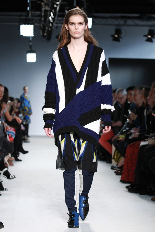 <strong>PUCCI </strong><BR><BR> Graphic prints and an obscured version of the mountain scene cropped up everywhere. And he played up the ski motif, with ski pants worn under skirts and dresses and booties that looked like mountain climbing shoes.