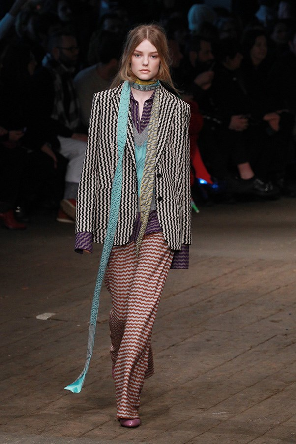 <strong>MISSONI</strong> <BR><BR> Coordinated zig-zag suits came in loose proportions, with button-down shirts and vests, while cropped sweaters and blanket-like scarves topped knit striped leggings.