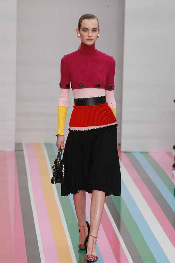 <strong>SALVATORE FERRAGAMO</strong> <BR><BR> Everything worked in bands and lines here. Horizontal pieces of ribbed knits were spliced together in witty mixes of color blocks and then paired with tightly-pleated skirts. Even his shoes—slim cabana striped T-straps picked up the theme.