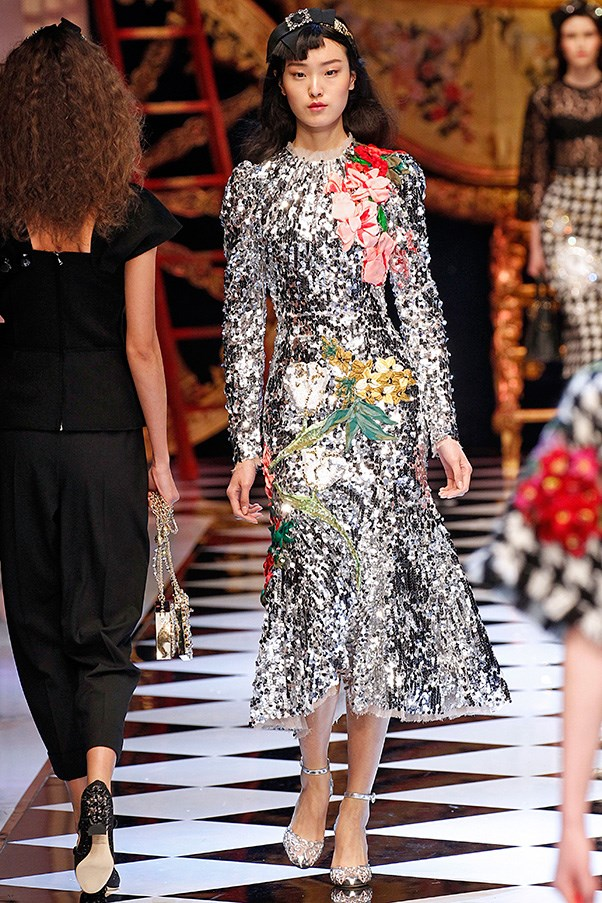 <strong>DOLCE & GABBANA</strong> <BR><BR> The penultimate dramatic scene of any fairy tale romance is the ball. Here, it was translated through crystal-bright dazzling silver dresses—one an actual disco ball motif that could have also doubled as a cracked mirror metaphor. These, along with houndstooth and animal print dresses and skirts, were detailed with flowers.