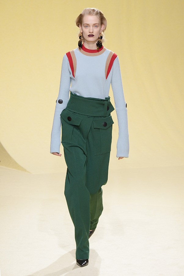 <strong>MARNI</strong> <BR><BR> Trim knit sweaters with athletic stripes sported those signature color combinations that are pure Marni. Red, mustard, light blue and dark green, for instance, which were then worked together in a print pastiche on loosely belted dresses, blouses gathered at the neck and paper bag-waist skirts.