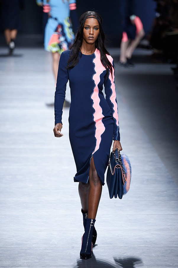 <strong>VERSACE</strong><br><br> One particular motif was especially strong. A handful of slim navy dresses featured either a pink or yellow paint blur from shoulder to hem. It was a recurring theme in different iterations, as edging on minis and along skinny Royal Tenenbaum-like suits.