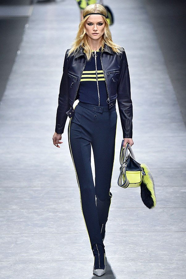 <strong>VERSACE</strong><br><br> The track suit got a chic, polished update here with motorcycle jacket toppers, skinnier ski-pant proportions and stirrups. Stirrups, in fact, were used throughout, creating a longer, lean leg.