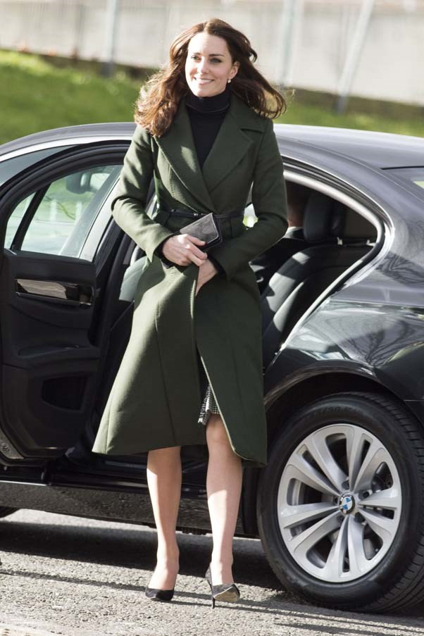 Kate Middleton steps out in a black turtleneck and a belted, bottle green Sportmax coat during her trip to Scotland.