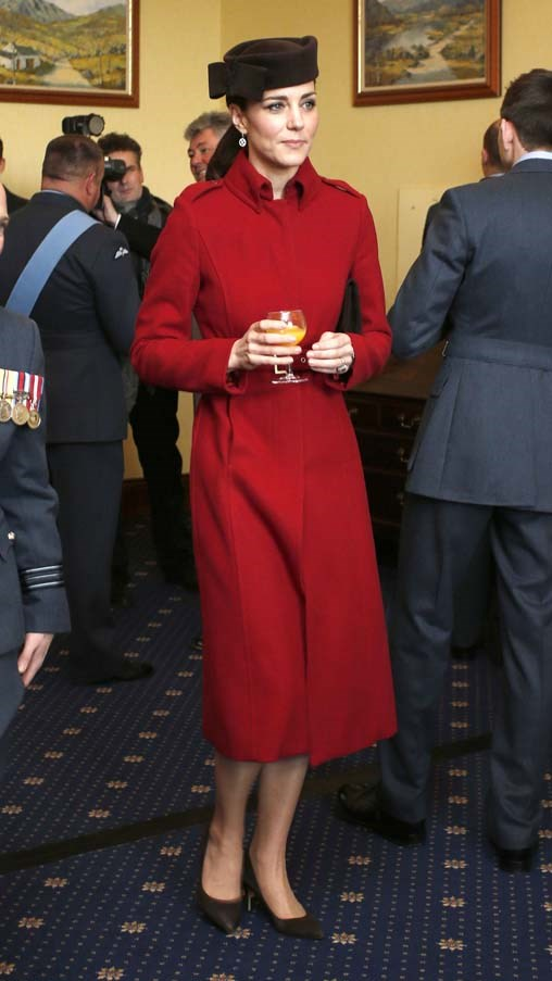 In her signature silhouette of long coats and simple pumps, the Duchess looked stunning in a red ensemble by LK Bennett as she attended a ceremony marking the end of the RAF Search and Rescue at the Royal Air Force Valley.