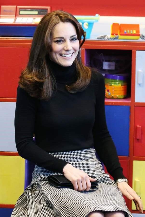 Middleton visited St Catherine's Primary School in a simple outfit of a black turtleneck and checkered kilt by emerging London fashion label Le Kilt.
