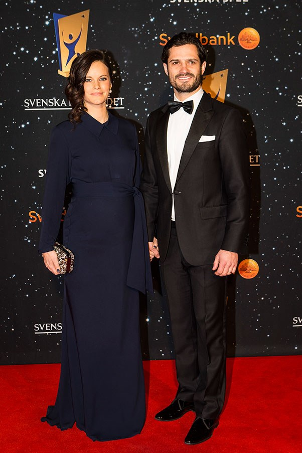 At the Swedish Sports Gala in January with husband Prince Carl Phillip, the Princess looks elegant in a floor length navy gown with a belt detail accentuating the growing bump.