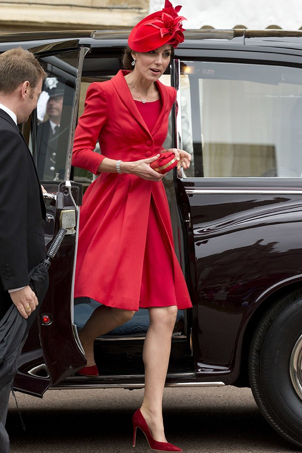 The Duchess wears a bright red Catherine Walker coat dress accessorised with a matching headpiece at the Order of the Garter Service at Windsor Castle.