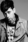 Why is Hedi Slimane Suing Saint Laurent Owners Kering