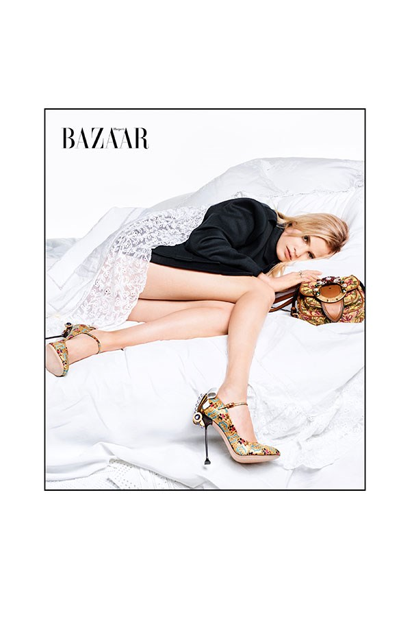 <strong>Lara:</strong><br> Jacket, bag & shoes: Miu Miu