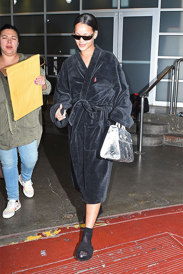 <strong>When:</strong> May 27th, 2016<br><br> <strong>What:</strong> Few people can actually lay claim to looking chic in a bathroom and slides, but RiRi can. I guess it helps when the robe is Ralph Lauren, the shoes are FENTY for Puma and it's accessorised with Dior x Rihanna sunglasses and Diorever tote.