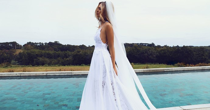 Ever wondered what defines a cult wedding dress? 2.5 million Pinterest pins later, we're pretty sure this Grace Loves Lace gown is it. Here, the dress that every bride is queuing up for.