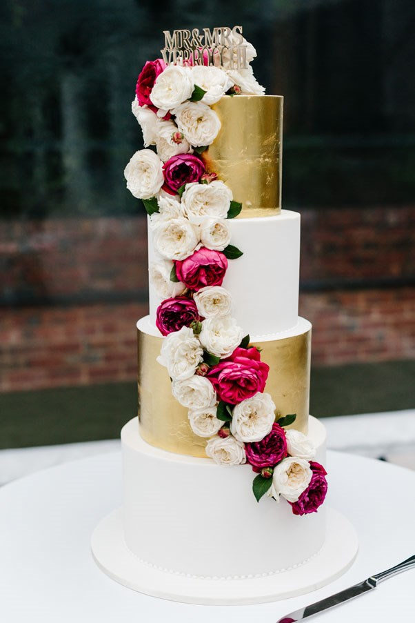 <strong>On the cake:</strong> <br><br> We both had a vision for a modern three tiered cake that we desired for our wedding day, which included fresh flowers from my bouquet, hints of gold leaf and a personalised translucent cake topper reading Mr & Mrs Verrocchi. The cake testing was highly contentious! After sampling ten different flavours we settled on alternating coconut, chocolate and hazelnut.