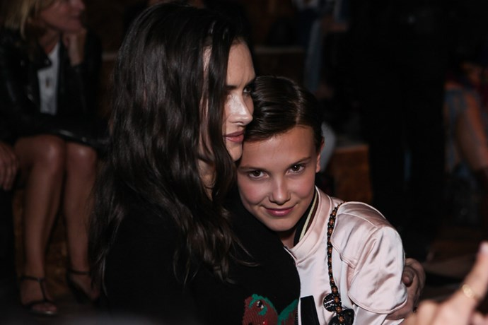 Stranger Things co-stars Winona Ryder and Millie Bobby Brown embrace at the Coach show.