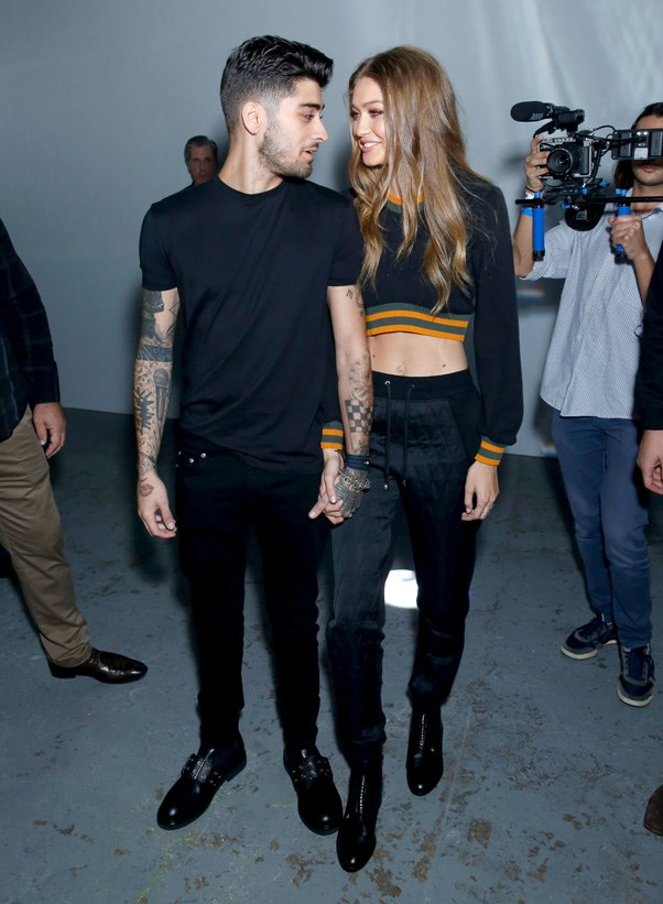 Gigi Hadid and pop star boyfriend Zayn Malik at Versus Versace.