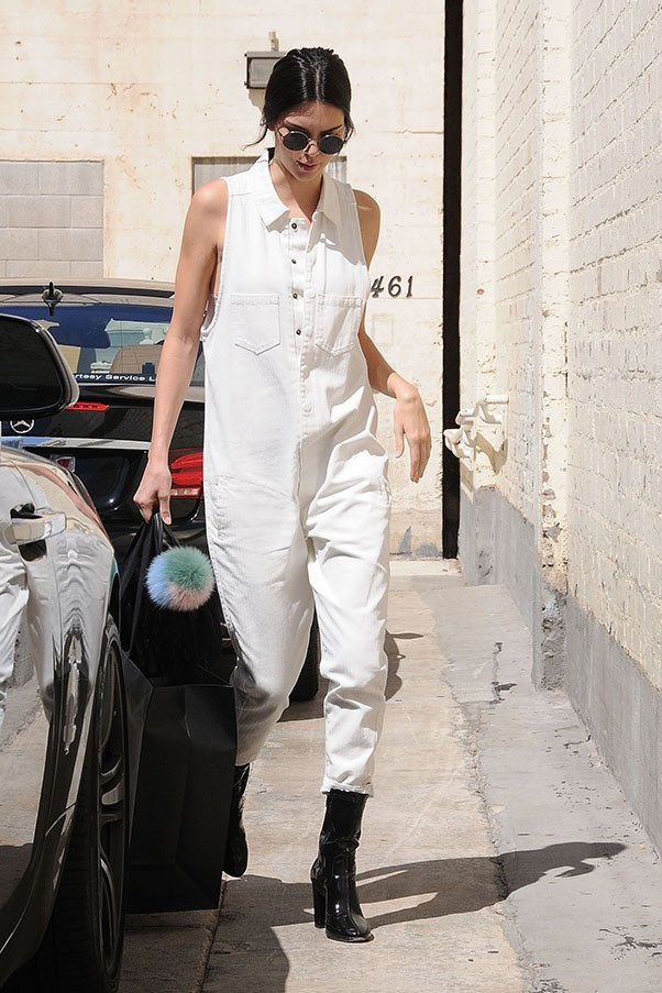 """<strong>One Teaspoon</strong> <br><br> Jenner wore an all-white denim jumpsuit by One Teaspoon in July this year. <br><br> Shop the look <a href=""""http://www.oneteaspoon.com.au/woman/shop-by-product/jumpsuits/braxton-utility-suit-6.html"""">here</a>."""