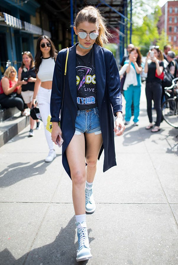 """<strong>One Teaspoon</strong> <br><br> Gigi wore One Teaspoon's signature denim 'Bandits' shorts in New York this year. <br><br> Shop the look <a href=""""http://www.oneteaspoon.com.au/blue-cult-bandits-11.html"""">here</a>."""