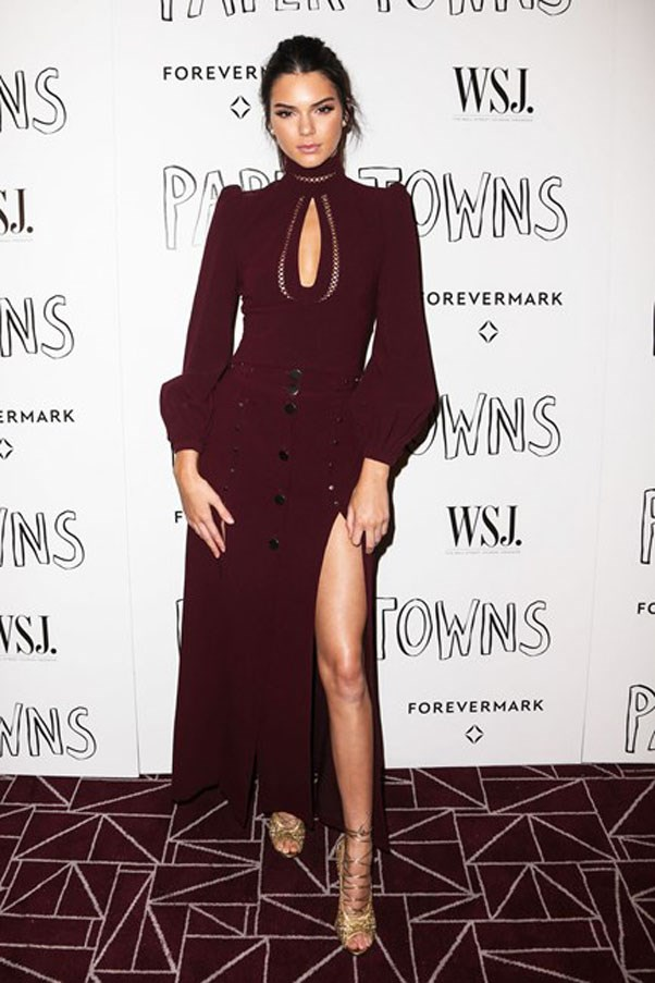 """<strong>Zimmermann</strong> <br><br> Kendall attended the premiere of bff Cara Delevigne's film <em>Paper Towns</em> in a rich red Zimmermann gown. <br><br> Shop similar <a href=""""https://www.zimmermannwear.com/readytowear/clothing/dresses#/?clearall=true&mode=product"""">here</a>."""