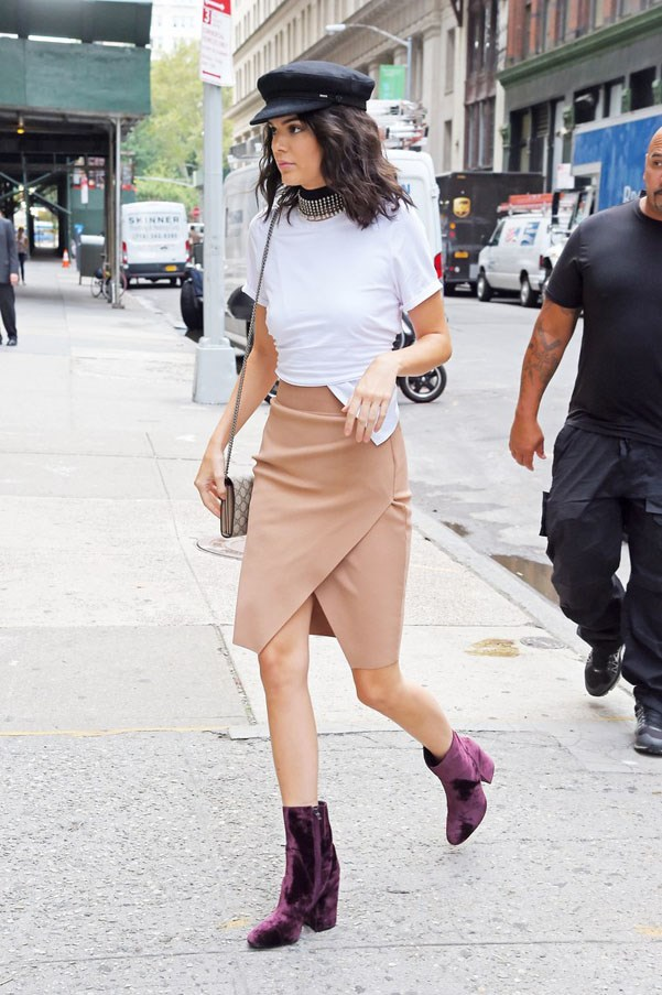 """<strong>Zimmermann</strong> <br><br> Jenner upgraded her neck-wear with a thick beaded embellished choker. <br><br> Shop the look <a href=""""https://www.zimmermannwear.com/metal-bead-choker-antique-brass.html"""">here</a>."""
