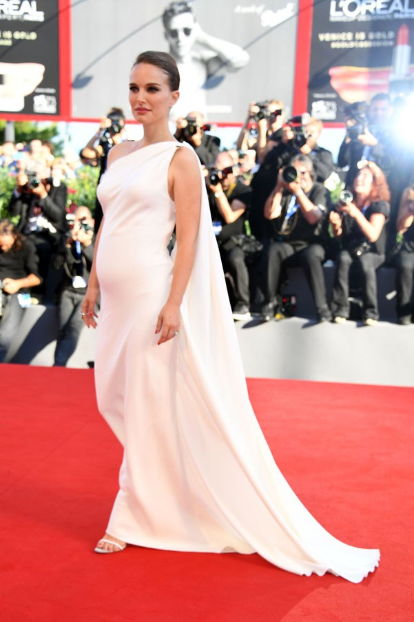 Natalie Portman donned a white gown adding to her existing pregnancy glow at the 2016 Venice Film Festival.