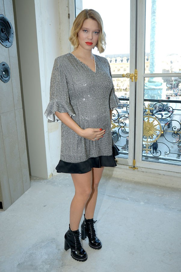 Lea Seydoux showed off her new bump at the Louis Vuitton show at Paris Fashion week.