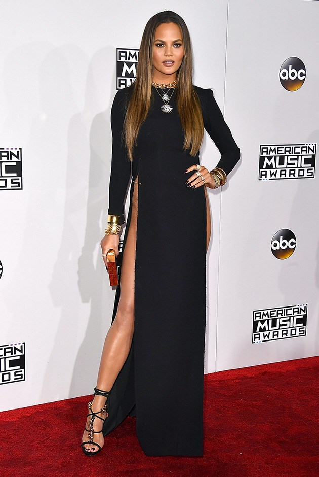 """<strong>Yousef Akbar</strong> <br><br> Chrissy Teigen stepped out in a headline-grabbing gown at the AMAs designed by a recent Sydney fashion graduate, Yousef Akbar. This piece is similar to others in his resort '17 collection, where daring splits and minimalist silhouettes reigned <br><br> See more from the young grad <a href=""""http://www.yousefakbar.com/collection/"""">here</a>."""