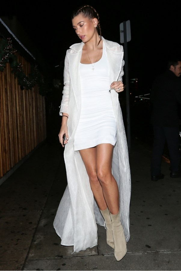 Hailey Baldwin opted for a white-on-white look, sticking to her tried-and-tested mini-dress/duster combo. <br><br> Image: Splash