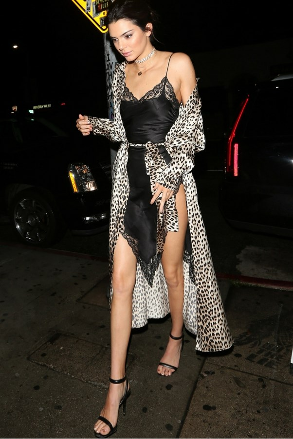 Kendall Jenner went full boudoir with a silky lace camisole worn under a leopard print robe. <br><br> Image: Splash
